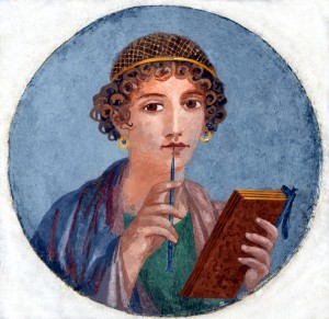 "Woman with wax tablets and stylus (so-called ""Sappho""). Image via Wikimedia Commons."