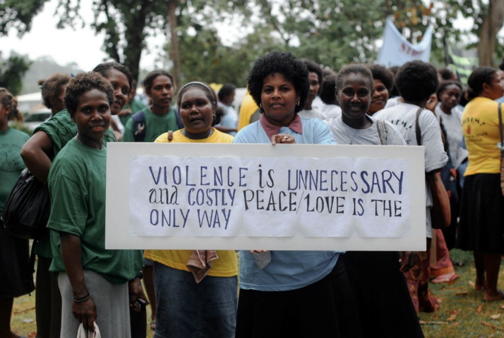 Women in the Solomon Islands gather on White Ribbon Day 2009 to rally against domestic violence. Image via Wikimedia Commons.