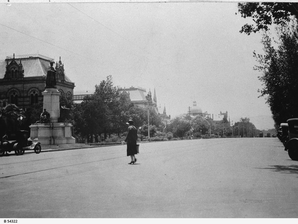 A woman crosses North Terrace, Adelaide. General view of North Terrace, c. 1928. Image via State Library of South Australia.