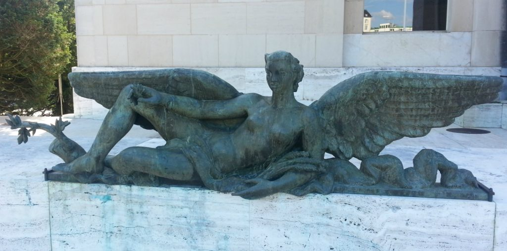 Winged sculpture, Palais des Nations, Geneva, Switzerland. The allegorical figure is one half of a male and female pair. Photograph by Fiona Paisley.