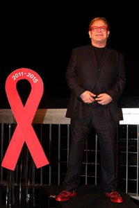 Elton John, World Aids Day; Substance, Circular Quay, Sydney (2011). Photograph by Eva Rinaldi Celebrity and Live Music Photographer. Image via Wikimedia Commons.