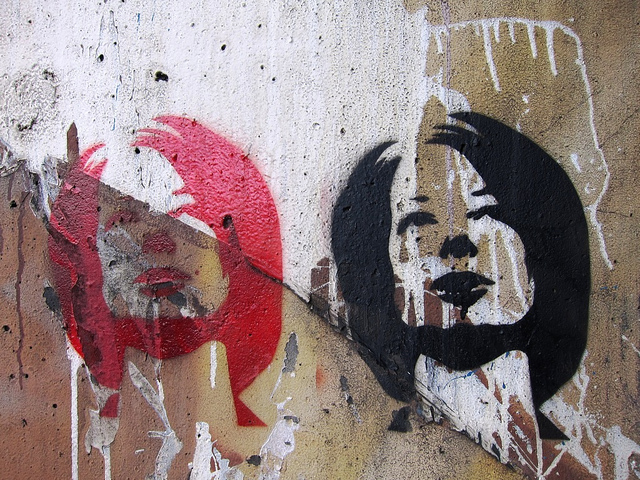 Julia Gillard in red and black under Burnley bridge, Melbourne, c. 2011. Artist unknown. Image via Flickr.