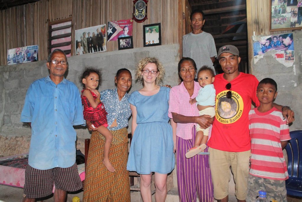 Hannah Loney with one of her interview participants and family in Baucau, Timor-Leste. Photograph by Joaquim Borges.
