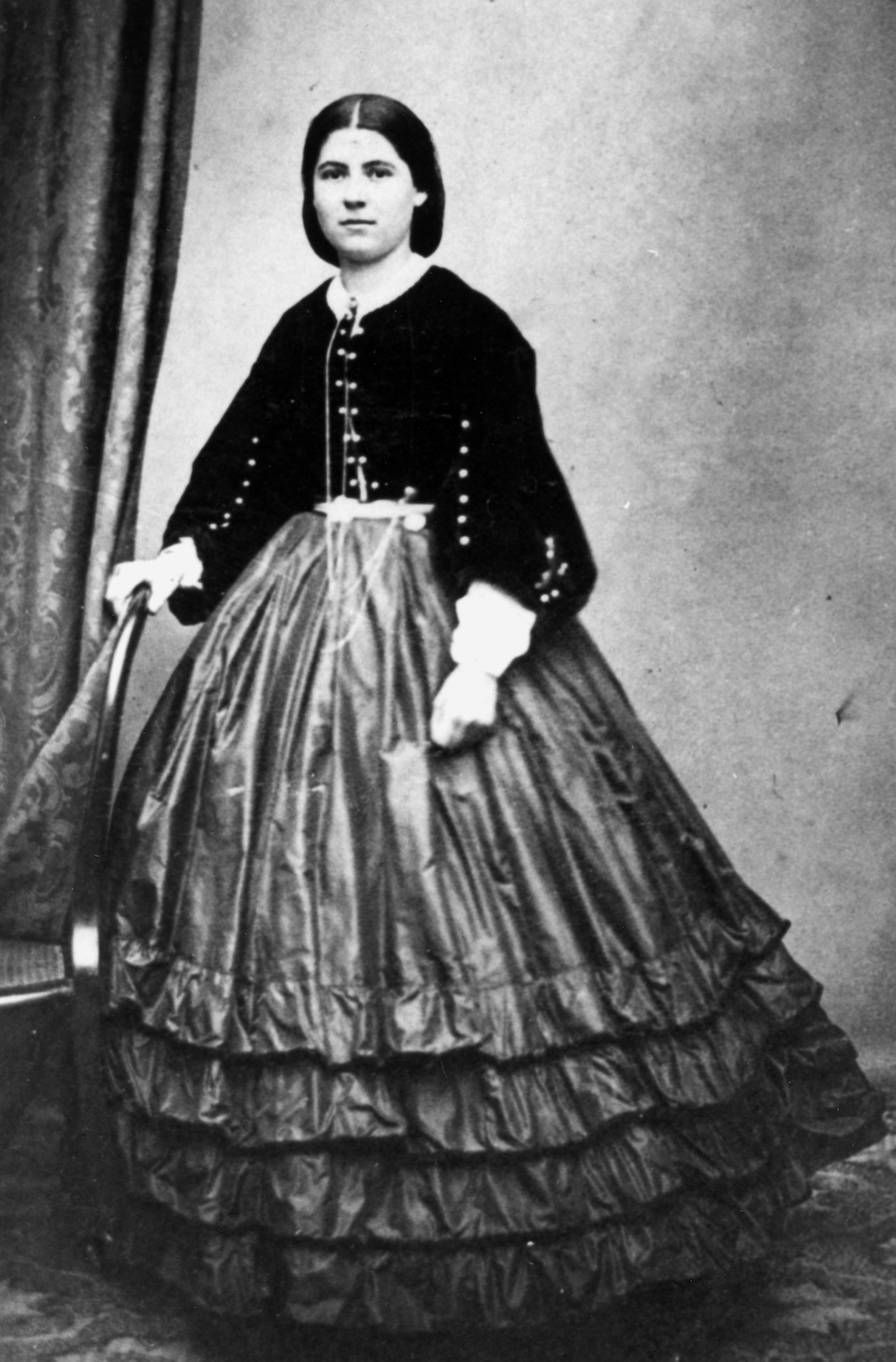3c5245fcbd56 Maria Catherine Leith-Hay wearing a large ruffled skirt and short-waisted  jacket, c. 1860-1870. Image via John Oxley Library, State Library of  Queensland.